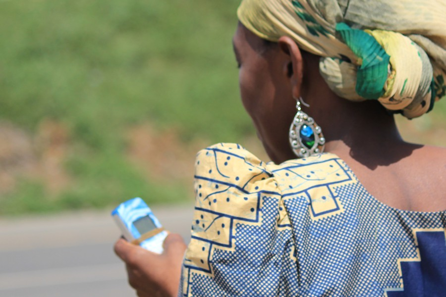 Arusha woman and her mobile phone.